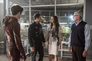 """The Flash -- """"The Man Who Saved Central City"""" -- Image FLA201b_0084b -- Pictured (L-R): Grant Gustin as Barry Allen/ The Flash, Robbie Amell as Ronnie, Danielle Panabaker as Caitlin Snow and Victor Garber as Professor Stein -- Photo: Cate Cameron /The CW -- © 2015 The CW Network, LLC. All rights reserved"""