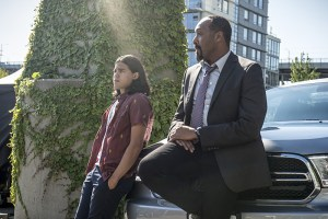 """The Flash -- """"The Man Who Saved Central City"""" -- Image FLA201a_0358b -- Pictured (L-R): Carlos Valdes as Cisco Ramon and Jesse L. Martin as Detective Joe West -- Photo: Cate Cameron /The CW -- © 2015 The CW Network, LLC. All rights reserved"""