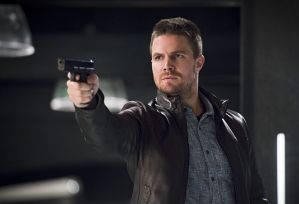 """The Flash -- """"Legends of Today"""" -- Image FLA208A_0317b.jpg -- Pictured: Stephen Amell as Oliver Queen -- Photo: Diyah Pera/The CW -- © 2015 The CW Network, LLC. All rights reserved."""