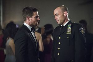 "Arrow -- ""Brotherhood"" -- Image AR407B_136b.jpg -- Pictured: Stephen Amell as Oliver Queen and Paul Blackthorne as Detective Quentin Lance -- Photo: Cate Cameron/The CW -- © 2015 The CW Network, LLC. All Rights Reserved."