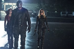 """Arrow -- """"Lost Souls"""" -- Image AR406B_0346b.jpg -- Pictured (L-R): Willa Holland as Thea Queen, David Ramsey as John Diggle and Katie Cassidy as Laurel Lance -- Photo: Cate Cameron/ The CW -- © 2015 The CW Network, LLC. All Rights Reserved."""