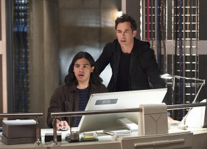 "The Flash -- ""Enter Zoom"" -- Image FLA206C_0013b.jpg -- Pictured (L-R): Carlos Valdes as Cisco Ramon and Tom Cavanagh as Harrison Wells  -- Photo: Cate Cameron/The CW -- © 2015 The CW Network, LLC. All rights reserved."
