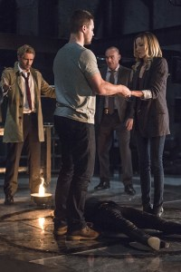 "Arrow -- ""Haunted"" -- Image AR404B_0060b.jpg -- Pictured (L-R): Matt Ryan as Constantine, Stephen Amell as Oliver Queen, Paul Blackthorne as Detective Quentin Lance and Katie Cassidy as Laurel Lance -- Photo: Cate Cameron/ The CW -- © 2015 The CW Network, LLC. All Rights Reserved."