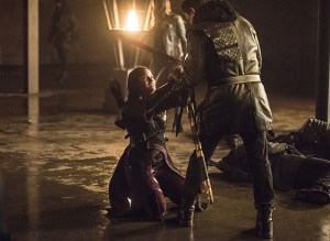 """Arrow -- """"Sins of the Father"""" -- Image AR413b_0498b.jpg -- Pictured (L-R):  Katrina Law as Nyssa al Ghul and John Barrowman as Malcolm Merlyn -- Photo: Dean Buscher/ The CW -- © 2016 The CW Network, LLC. All Rights Reserved."""