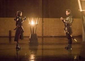 "Arrow -- ""Sins of the Father"" -- Image AR413b_0292b.jpg -- Pictured (L-R):  Katrina Law as Nyssa al Ghul and John Barrowman as Malcolm Merlyn -- Photo: Dean Buscher/ The CW -- © 2016 The CW Network, LLC. All Rights Reserved."