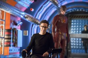"""The Flash -- """"Flash Back"""" -- Image: FLA217b_0307b.jpg -- Pictured (L-R) Tom Cavanagh as Harrison Wells and Grant Gustin as The Flash -- Photo: Diyah Pera/The CW -- © 2016 The CW Network, LLC. All rights reserved."""