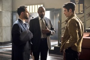 """The Flash -- """"Invincible"""" -- Image: FLA222b_0301b.jpg -- Pictured (L-R): Patrick Sabongui as Captain Singh, Jesse L. Martin as Detective Joe West and Grant Gustin as Barry Allen -- Photo: Dean Buscher/The CW -- © 2016 The CW Network, LLC. All rights reserved."""