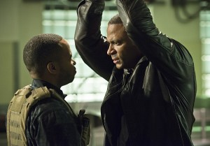 """Arrow -- """" Genesis"""" -- Image AR420a_0077b.jpg -- Pictured (L-R): Eugene Byrd as Andy Diggle and David Ramsey as John Diggle -- Photo: Diyah Pera/The CW -- © 2016 The CW Network, LLC. All Rights Reserved."""