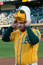 Oakland Athletics pitcher Liam Hendriks (31) puts on an Athletics Dark Vader mask to catch one of the ceremonial first pitches prior to the game between the Athletics and the Seattle Mariners at the Oakland Coliseum in Oakland, Calif., on August 13, 2016.