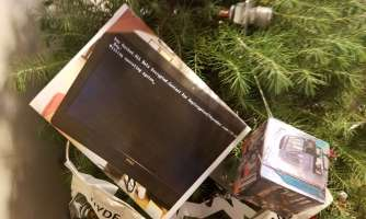 A photo of a SFMTA computer that was affected by the Thanksgiving ransomware attack hangs on a Christmas tree outside of SFMTA's Director of Transit John Haley's office.