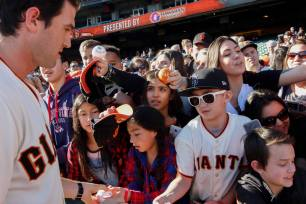 Cory Gearrin (62) signs autographs during the Giants Fan Fest at AT&T Park on Feb. 11, 2017.