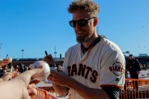 Hunter Pence signs autographs during the Giants Fan Fest at AT&T Park on Feb. 11, 2017.