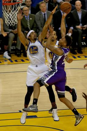 Golden State Warriors forward James Michael McAdoo (20) blocks Sacramento Kings guard Malachi Richardson (5) in the first half as the Sacramento Kings face the Golden State Warriors at Oracle Arena in Oakland, Calif., on Wednesday, February 15, 2017.