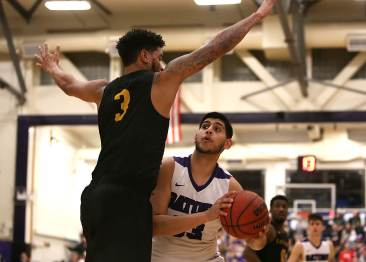 SF State Gators forward Chiefy Ugbaja (23) gets Cal State LA forward Travis Hammonds (3) in the air then scores as the SF State Gators take on the Cal State LA Golden Eagles in a CCAA first round playoff game at SF State University in San Francisco, Calif., on Tuesday, February 28, 2017.