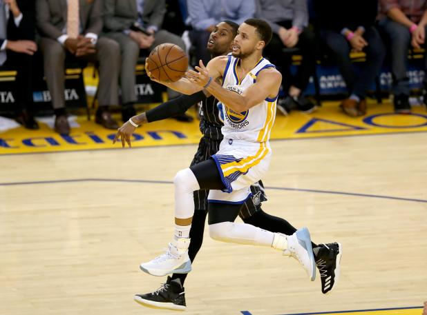 Golden State Warriors guard Stephen Curry (30) drives to the hoop for two in the first half as the Orlando Magic face the Golden State Warriors at Oracle Arena in Oakland, Calif., on Thursday, March 16, 2017.