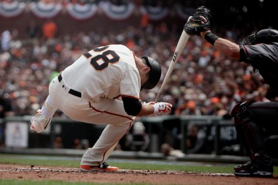 San Francisco Giants catcher Buster Posey (28) is hit by a pitch in the first inning as the Arizona Diamondbacks face the San Francisco Giants on opening day at AT&T Park in San Francisco, Calif., on Monday, April 10, 2017.