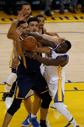 Golden State Warriors forward Draymond Green (23) fights for a rebound in the first half as the Utah Jazz face the Golden State Warriors at Oracle Arena in Oakland, Calif., on Monday, April 10, 2017.