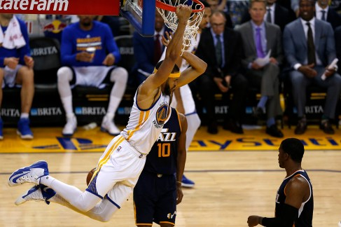 Golden State Warriors center Javale McGee (1) swings on the rim after a second half dunk as the Utah Jazz face the Golden State Warriors at Oracle Arena in Oakland, Calif., on Monday, April 10, 2017.