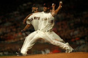 San Francisco Giants starting pitcher Madison Bumgarner (40) throws a pitch in the fifth inning as shown in a multiple exposure as the Colorado Rockies face the San Francisco Giants at AT&T Park in San Francisco, Calif., on Thursday, April 13, 2017.