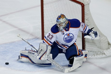 Edmonton Oilers goal keeper Cam Talbot (33) stops a shot on goal in the first period as the Edmonton Oilers take on the San Jose Sharks at the SAP Center in San Jose, Calif., on Tuesday, April 18, 2017.