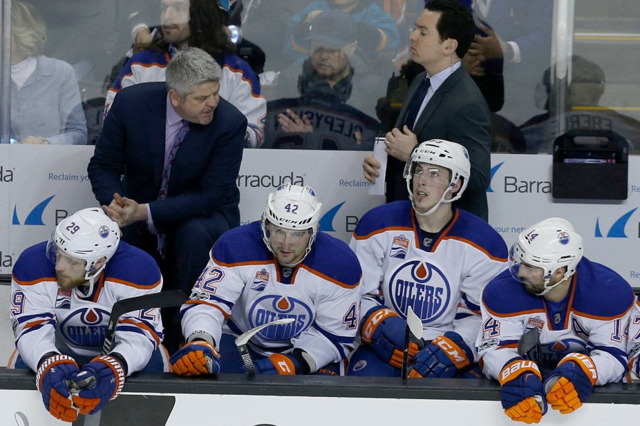Edmonton Oilers head coach Todd McLellan talks to players on the bench as the Edmonton Oilers take on the San Jose Sharks at the SAP Center in San Jose, Calif., on Tuesday, April 18, 2017.