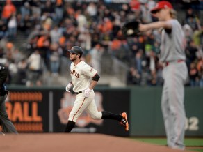 San Francisco Giants first baseman Brandon Belt (9) rounds the bases after a home run off of Cincinnati Reds starting pitcher Bronson Arroyo (61) in the first inning as the Cincinnati Reds face the San Francisco Giants at AT&T Park in San Francisco, Calif., on Thursday, May 11, 2017.