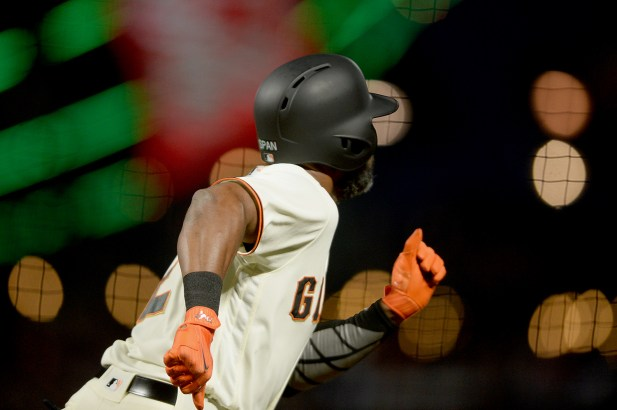 San Francisco Giants center fielder Denard Span (2) watches a home run in the fifth inning as the Cincinnati Reds face the San Francisco Giants at AT&T Park in San Francisco, Calif., on Thursday, May 11, 2017.