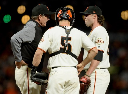 San Francisco Giants pitching coach Dave Righetti (19) talks with San Francisco Giants relief pitcher Hunter Strickland (60) in the eighth inning as the Cincinnati Reds face the San Francisco Giants at AT&T Park in San Francisco, Calif., on Thursday, May 11, 2017.
