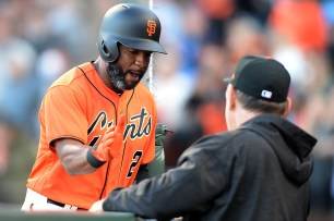 San Francisco Giants center fielder Denard Span (2) is congratulated by San Francisco Giants manager Bruce Bochy (15) after a first inning home run as the Cincinnati Reds face the San Francisco Giants at AT&T Park in San Francisco, Calif., on Friday, May 12, 2017.
