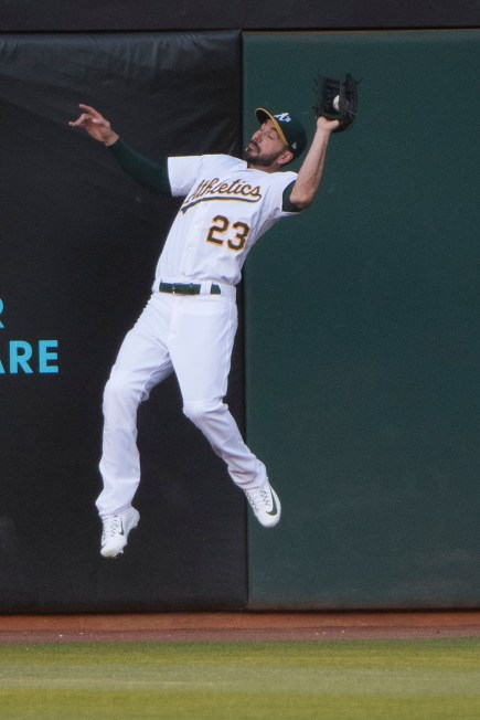 Oakland Athletics right fielder Matt Joyce (23) makes a leaping catch in the second inning of the game against the Boston Red Sox at the Oakland Coliseum in Oakland, Calif., on May 18, 2017.