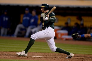 Oakland Athletics shortstop Adam Rosales(16) connects for an RBI single in the fifth inning as the Toronto Blue Jays face the Oakland Athletics at Oakland Coliseum in Oakland, Calif., on Tuesday, June 6, 2017.