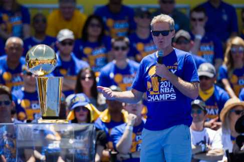 Flanked by the Larry O'Brien Championship Trophy, Golden State Warriors Head Coach Steve Kerr addresses the crowd at the Golden State Warriors 2017 NBA Championship rally Thursday in Oakland.