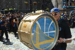 A drummer beats his drum as he marches at the Golden State Warriors championship parade in Oakland, Calif. on Thursday, Jun. 15, 2017.