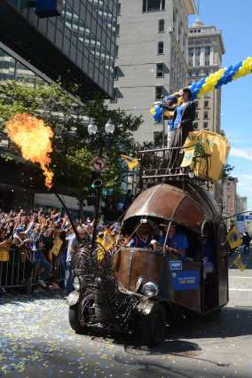 Oakland mayor Libby Schaaf rides a mechanical snail at the Golden State Warriors championship parade in Oakland, Calif. on Thursday, Jun. 15, 2017.