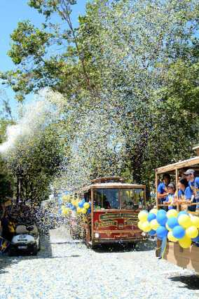 Ticker tape falls on trolley cars at the Golden State Warriors championship parade in Oakland, Calif. on Thursday, Jun. 15, 2017.
