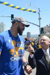 Warriors C JaVale McGee (1) is interviewed by ABC 7 news at the Golden State Warriors championship parade in Oakland, Calif. on Thursday, Jun. 15, 2017.