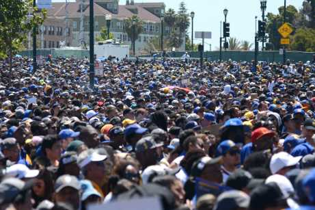 A massive crowd awaits the Warriors team at a rally after the Golden State Warriors championship parade at Lake Merritt in Oakland, Calif. on Thursday, Jun. 15, 2017.