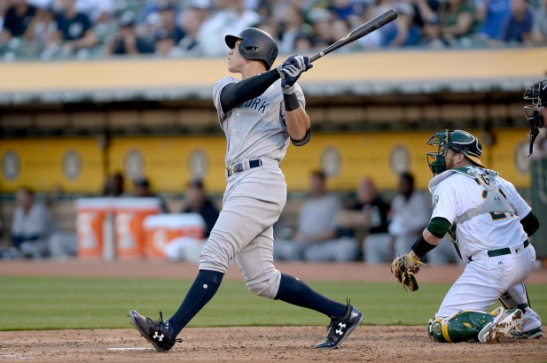 New York Yankees right fielder Aaron Judge (99) crushes a 3-run home run in the third inning as the New York Yankees face the Oakland Athletics at Oakland Coliseum in Oakland, Calif., on Friday, June 16, 2017.
