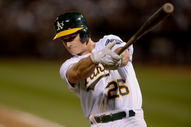 Oakland Athletics third baseman Matt Chapman (26) takes a swing in the on deck circle in the eighth inning as the New York Yankees face the Oakland Athletics at Oakland Coliseum in Oakland, Calif., on Friday, June 16, 2017.