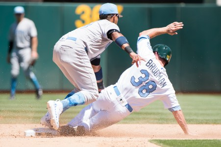 New York Yankees second baseman Starlin Castro (14) tags Oakland Athletics center fielder Jaycob Brugman (38) on a steal attempt in the fourth inning of the game against the Oakland Athletics at the Oakland Coliseum in Oakland, Calif., on June 18, 2017.