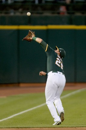 Oakland Athletics third baseman Ryon Healy (25) chases down an Aoki foul out in the fifth inning as the Houston Astros face the Oakland Athletics at Oakland Coliseum in Oakland, Calif., on Wednesday, June 21, 2017.
