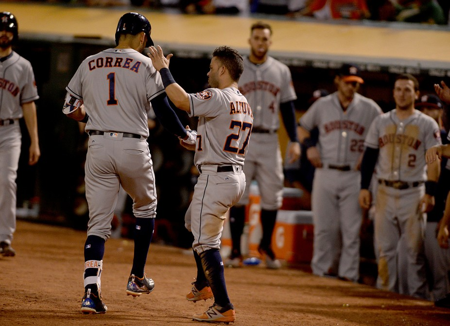 Houston Astros shortstop Carlos Correa (1) is congratulated after hitting a home run in the ninth inning as the Houston Astros face the Oakland Athletics at Oakland Coliseum in Oakland, Calif., on Wednesday, June 21, 2017.