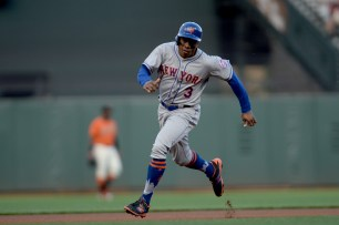 New York Mets right fielder Curtis Granderson (3) advances to third base in the first inning as the New York Mets face the San Francisco Giants at AT&T Park in San Francisco, Calif., on Friday, June 23, 2017.