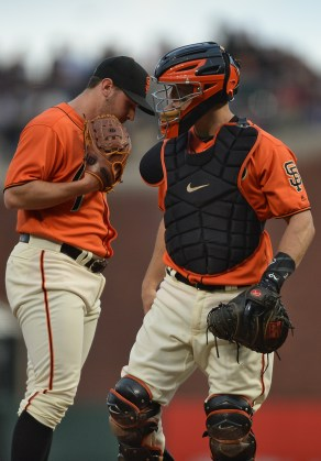 San Francisco Giants catcher Nick Hundley (5) makes a trip to the mound in the second inning to talk to San Francisco Giants starting pitcher Ty Blach (50) as the New York Mets face the San Francisco Giants at AT&T Park in San Francisco, Calif., on Friday, June 23, 2017.