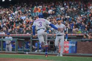 New York Mets right fielder Curtis Granderson (3) high fives Mets center fielder Michael Conforto (30) after scoring a run in the first inning as the New York Mets face the San Francisco Giants at AT&T Park in San Francisco, Calif., on Friday, June 23, 2017.