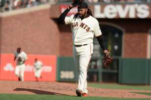San Francisco Giants pitcher Johnny Cueto (47) removes his cap after striking out New York Mets right fielder Curtis Granderson (3) in the fifth inning as the New York Mets face the San Francisco Giants at AT&T Park in San Francisco, Calif., on Friday, June 24, 2017.