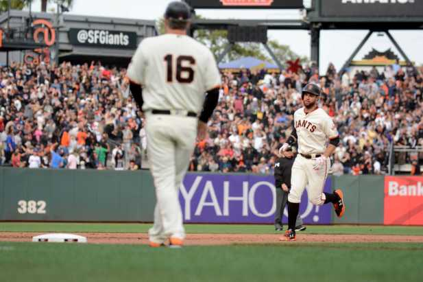 San Francisco Giants second baseman Brandon Belt (9) rounds third base after hitting a home run in the seventh inning as the New York Mets face the San Francisco Giants at AT&T Park in San Francisco, Calif., on Friday, June 24, 2017.
