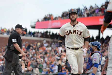 San Francisco Giants second baseman Brandon Belt (9) crosses home after hitting a home run in the seventh inning as the New York Mets face the San Francisco Giants at AT&T Park in San Francisco, Calif., on Friday, June 24, 2017.