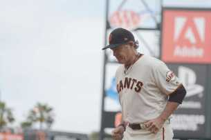 San Francisco Giants pitching coach Dave Righetti (19) runs off the field in the eighth inning as the New York Mets face the San Francisco Giants at AT&T Park in San Francisco, Calif., on Friday, June 24, 2017.
