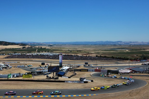 Racecars complete the first lap at the Toyota/Save Mart 350 at Sonoma Raceway in Sonoma, Calif., on Sunday, June 24, 2017.